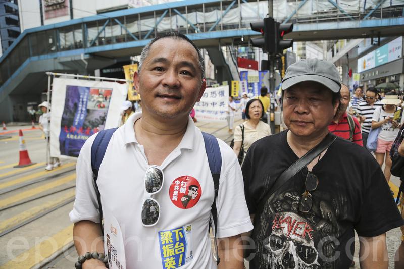 2016香港七一大遊行,法輪功學員要求法辦迫害法輪功的元兇江澤民,在法輪功隊伍經過時,有市民大喊:「支持法輪功」。(余鋼/大紀元)