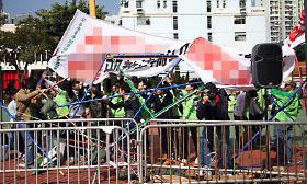 特首梁振英上任以來侵擾香港法輪功活動的青關會,是中共政法委610系統轄下機構。(大紀元資料圖片)